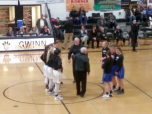 Both teams meet with the officials prior to Gwinn's 51-49 overtime win over Ishpeming on 98.3 WRUP.