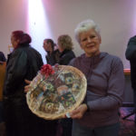 Susan Ellis from Ishpeming holds up her prize from Super One Foods