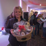 Tammie Kaukola from Skandia posing with her basket from Econo Foods!