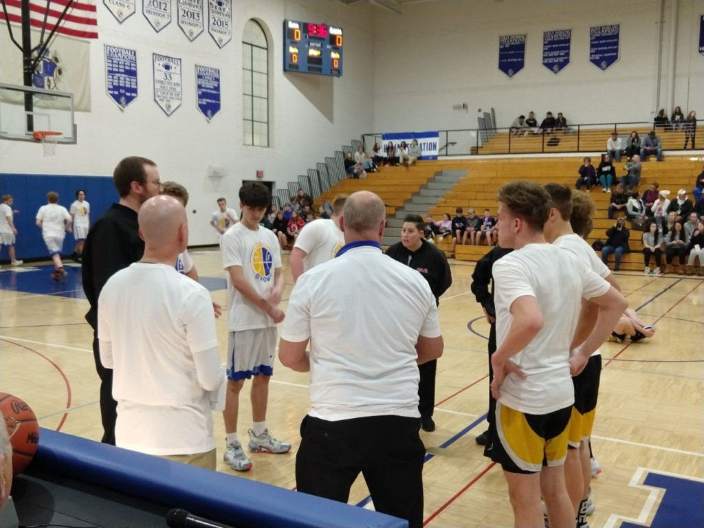 Ishpeming and Gwinn Sporting their Dion Brown Warmups