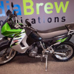 This green, silver, and black bike has under 21,000 miles!